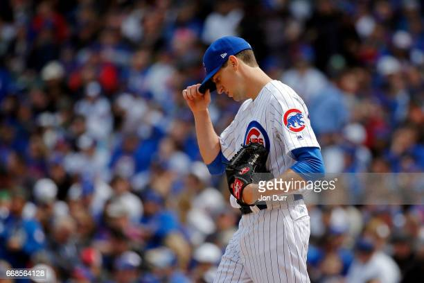 Kyle Hendricks of the Chicago Cubs reacts after throwing a pitch to Gerrit Cole of the Pittsburgh Pirates during the second inning at Wrigley Field...
