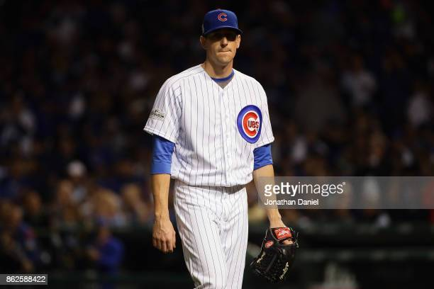 Kyle Hendricks of the Chicago Cubs walks off the field after being relieved in the sixth inning against the Los Angeles Dodgers during game three of...