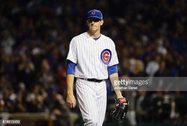 Kyle Hendricks of the Chicago Cubs walks off the mound after being relieved in the fifth inning against the Cleveland Indians in Game Three of the...
