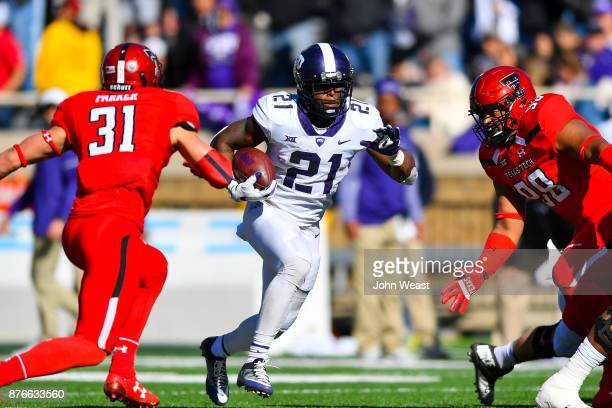 Kyle Hicks of the TCU Horned Frogs goes between Justus Parker of the Texas Tech Red Raiders and Nick McCann of the Texas Tech Red Raiders during the...
