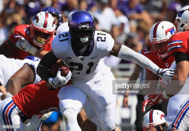 Kyle Hicks of the TCU Horned Frogs runs the ball against the Southern Methodist Mustangs at Amon G Carter Stadium on September 16 2017 in Fort Worth...