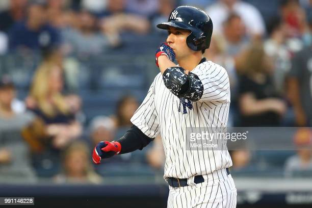 Kyle Higashioka of the New York Yankees celebrates after connecting on a solo home run in the bottom of the second inning against the Atlanta Braves...