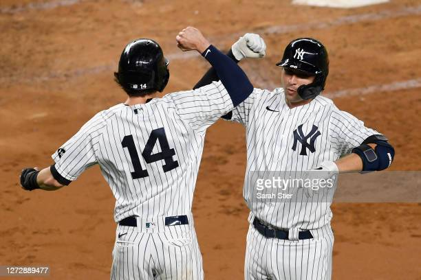 Kyle Higashioka of the New York Yankees celebrates with Tyler Wade after Higashioka hit a tworun home run during the third inning against the Toronto...