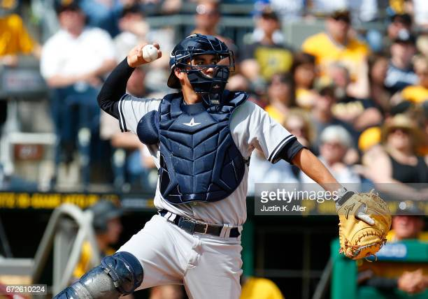 Kyle Higashioka of the New York Yankees in action against the Pittsburgh Pirates at PNC Park on April 23 2017 in Pittsburgh Pennsylvania