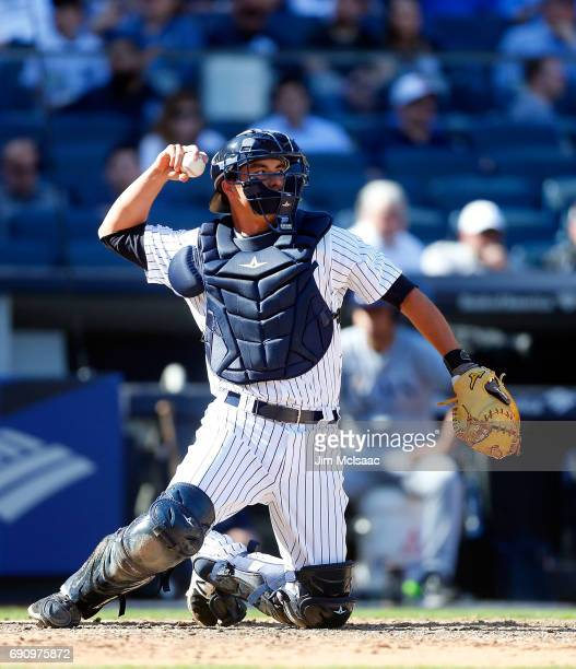 Kyle Higashioka of the New York Yankees in action against the Tampa Bay Rays on Opening Day at Yankee Stadium on April 10 2017 in the Bronx borough...