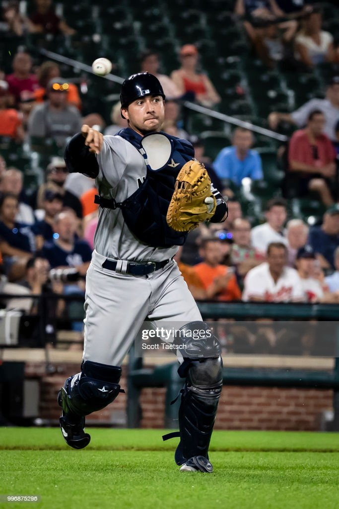 Kyle Higashioka #66 of the New York Yankees makes a throw to first to retire Tim Beckham #1 of the Baltimore Orioles (not pictured) during the eighth inning at Oriole Park at Camden Yards on July 11, 2018 in Baltimore, Maryland.