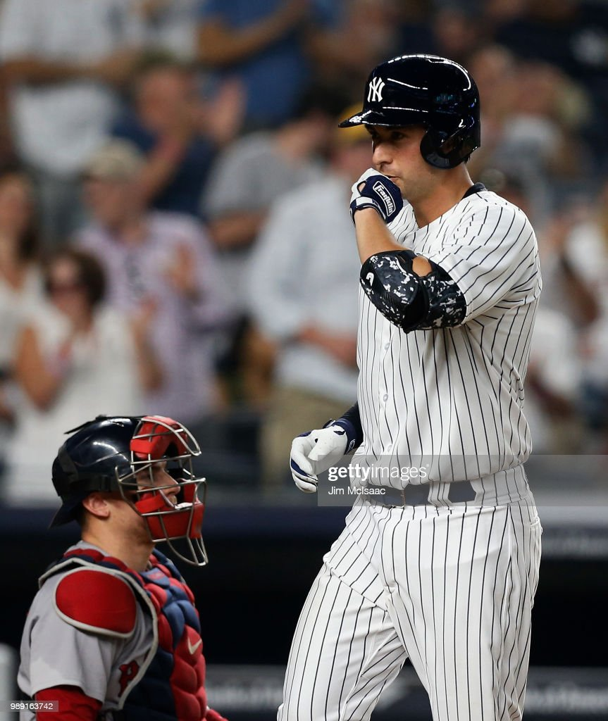 Kyle Higashioka #66 of the New York Yankees reacts at home plate after his fourth inning home run as Christian Vazquez #7 of the Boston Red Sox looks on at Yankee Stadium on July 1, 2018 in the Bronx borough of New York City. It was the first the major league hit for Higashioka.