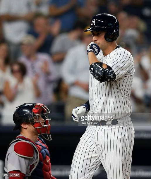 Kyle Higashioka of the New York Yankees reacts at home plate after his fourth inning home run as Christian Vazquez of the Boston Red Sox looks on at...