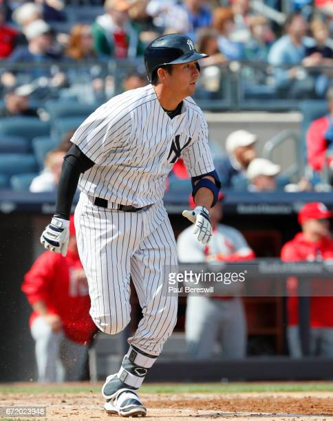 Kyle Higashioka of the New York Yankees runs to first base in an MLB baseball game against the St Louis Cardinals on April 15 2017 at Yankee Stadium...
