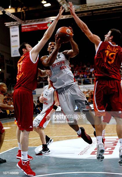 Kyle Hines #42 of Brose Baskets competes with Andrea Crosariol #11 and Vladimir Dasic #19 of Lottomatica Roma during the 20102011 Turkish Airlines...