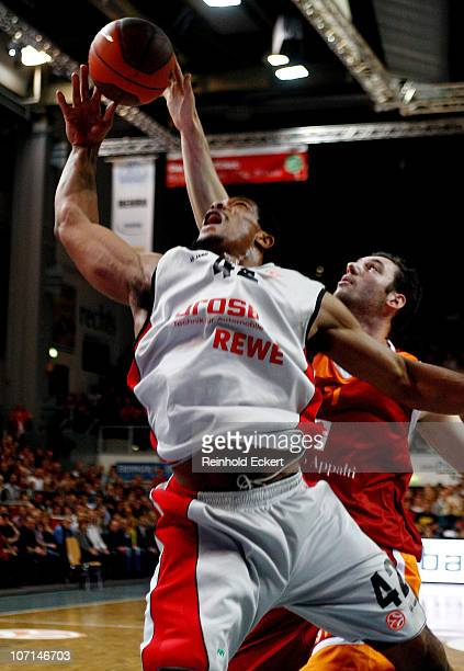 Kyle Hines #42 of Brose Baskets competes with Andrea Crosariol #11 of Lottomatica Roma during the 20102011 Turkish Airlines Euroleague Regular Season...