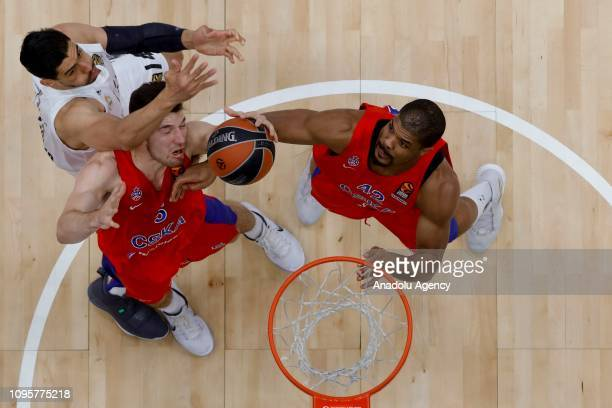Kyle Hines and Alec Peters of CSKA Moscow vies with Gustavo Ayon of Real Madrid during the Turkish Airlines Euroleague match between CSKA Moscow and...
