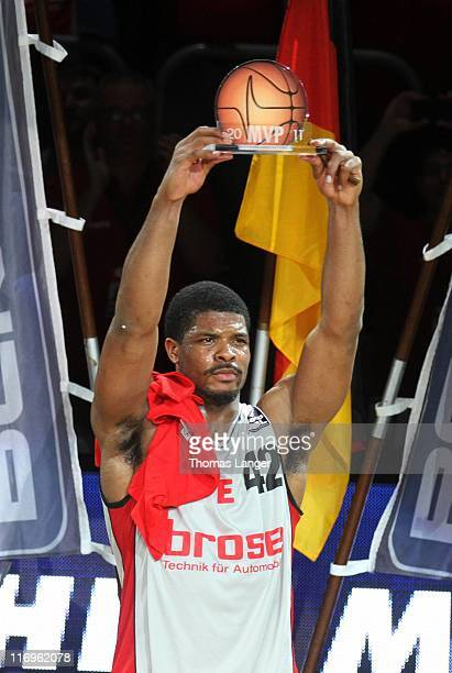 Kyle Hines of Bamberg is awarded with the trophy for the most valuable player after the Beko BBL Playoffs Final game five between Brose Baskets...