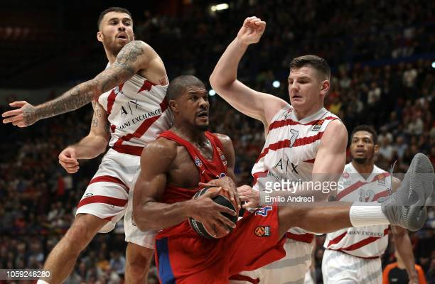 Kyle Hines of CSKA Moscow jumps for a rebound against Mike James and Arturas Gudaitis of AX Armani Exchange Olimpia Milanduring the Turkish Airlines...
