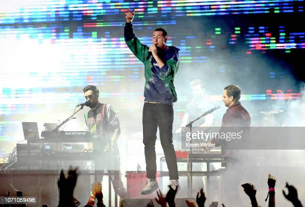 Kyle J Simmons Dan Smith and Will Farquarson of Bastille perform on stage during KROQ Absolut Almost Acoustic Christmas at The Forum on December 9...