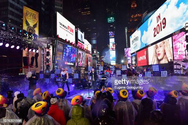 Kyle J Simmons Dan Smith Chris Wood and Will Farquarson of Bastille perform on stage during Dick Clark's New Year's Rockin' Eve With Ryan Seacrest...
