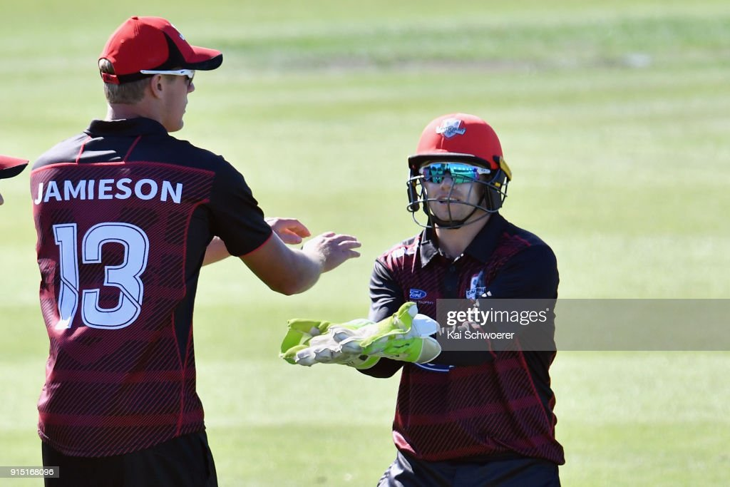 Kyle Jamieson of Canterbury is congratulated by Tom Latham of Canterbury (L-R) after dismissing Glenn Phillips of the Auckland Aces during the One Day Ford Trophy Cup match between Canterbury and Auckland on February 7, 2018 in Christchurch, New Zealand.