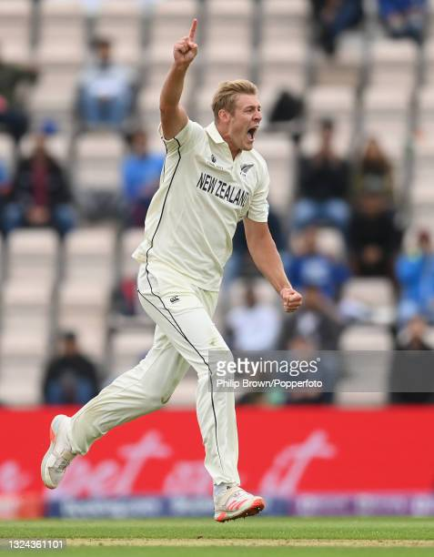 Kyle Jamieson of New Zealand celebrates after dismissing Rohit Sharma of India during Day 2 of the ICC World Test Championship Final between India...