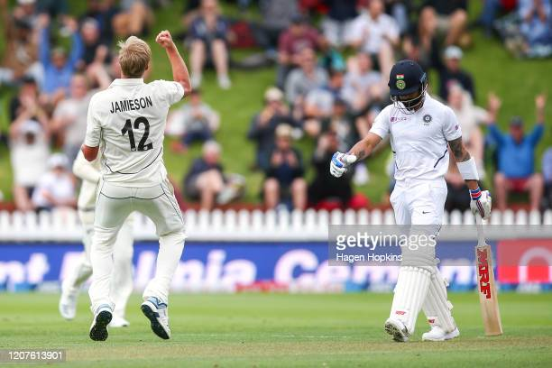 Kyle Jamieson of New Zealand celebrates after taking the wicket of Virat Kohli of India during day one of the First Test match between New Zealand...