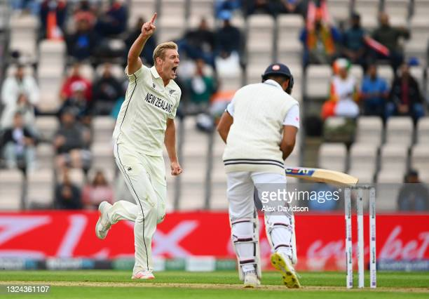 Kyle Jamieson of New Zealand celebrates taking the wicket of Rohit Sharma of India during Day 2 of the ICC World Test Championship Final between...
