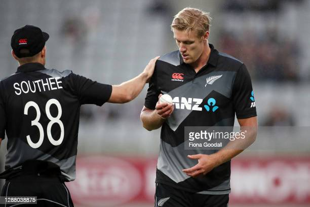Kyle Jamieson of New Zealand gets some encouragement from Tim Southee, captain of New Zealand, on his debut during game one of the International T20...