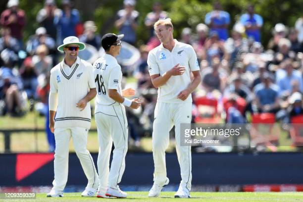 Kyle Jamieson of New Zealand is congratulated by Colin de Grandhomme of New Zealand and Trent Boult of New Zealand after dismissing Prithvi Shaw of...
