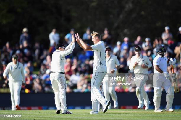 Kyle Jamieson of New Zealand is congratulated by team mates after dismissing Rishabh Pant of India during day one of the Second Test match between...