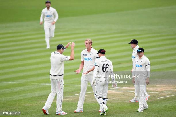 Kyle Jamieson of New Zealand is congratulated by team mates after dismissing Darren Bravo of the West Indies during day three of the First Test match...