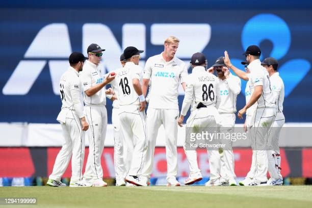 Kyle Jamieson of New Zealand is congratulated by team mates after dismissing Abid Ali of Pakistan during day one of the Second Test match in the...
