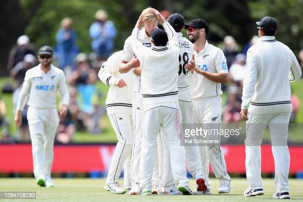 Kyle Jamieson of New Zealand is congratulated by team mates after dismissing Mohammad Rizwan of Pakistan during day four of the Second Test match in...