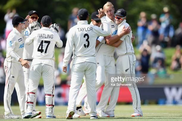 Kyle Jamieson of New Zealand is congratulated by team mates after dismissing Faheem Ashraf of Pakistan during day four of the Second Test match in...
