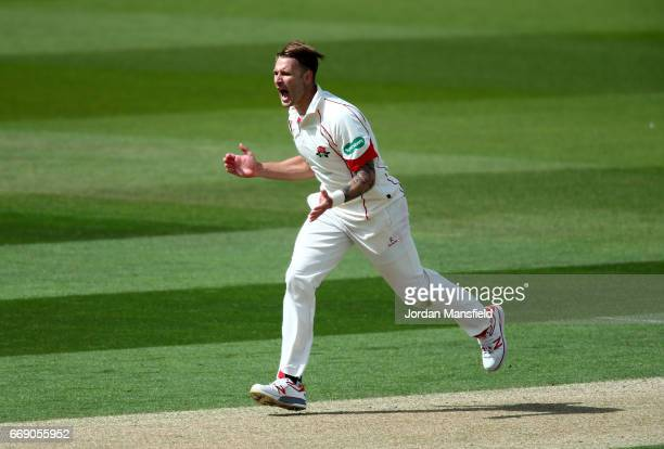Kyle Jarvis of Lancashire celebrates getting the wicket of Rory Burns of Surrey during day three of the Specsavers County Championship Division One...