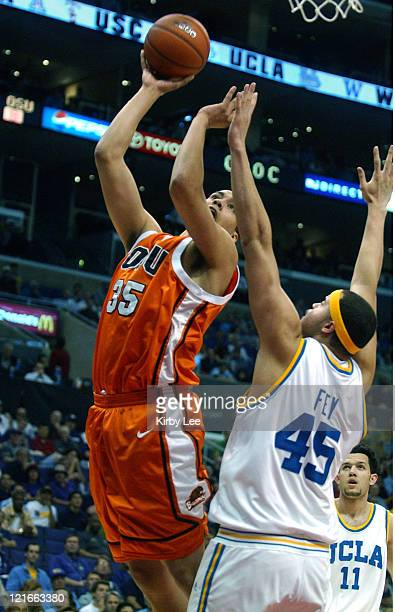 Kyle Jeffers of Oregon State shoots over Michael Fey of UCLA during 7972 firstround victory in the Pacific Life Pac10 men's basketball tournament at...