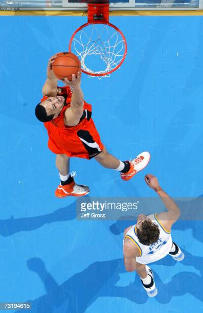 Kyle Jeffers of the Oregon State Beavers goes up for a dunk over James Keefe of the UCLA Bruins in the second half of the game at Pauley Pavilion on...