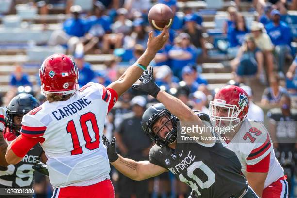 Kyle Johnson of the Air Force Falcons reaches to block Joe Carbone of the Stony Brook Seawolves at Falcon Stadium on September 1 2018 in Colorado...