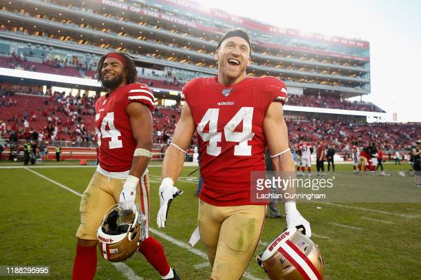 Kyle Juszczyk and Fred Warner of the San Francisco 49ers leave the field after their win against the Arizona Cardinals at Levi's Stadium on November...