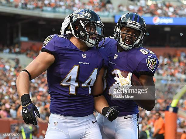 Kyle Juszczyk celebrates his second quarter touchdown with Torrey Smith of the Baltimore Ravens against the Cleveland Browns at FirstEnergy Stadium...