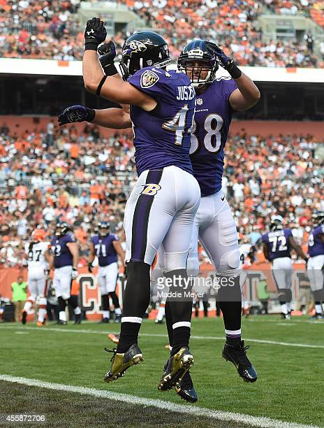Kyle Juszczyk celebrates his touchdown with Dennis Pitta of the Baltimore Ravens during the second quarter against the Cleveland Browns at...