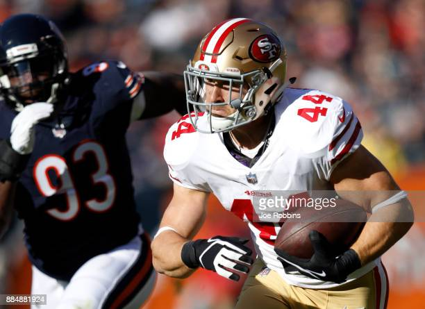 Kyle Juszczyk of the San Francisco 49ers carries the football in the first quarter against the Chicago Bears at Soldier Field on December 3 2017 in...