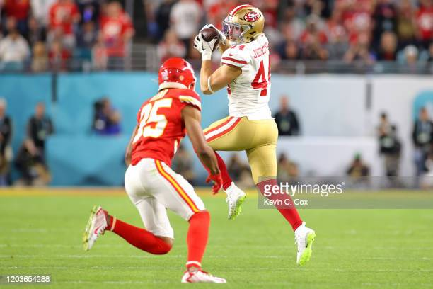 Kyle Juszczyk of the San Francisco 49ers catches a pass against Charvarius Ward of the Kansas City Chiefs during the third quarter in Super Bowl LIV...