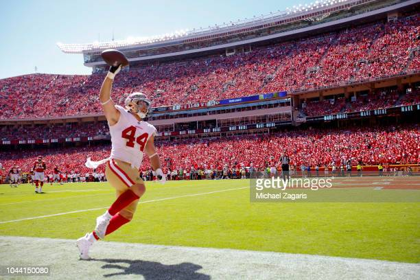 Kyle Juszczyk of the San Francisco 49ers celebrates after scoring on a 35yard touchdown reception during the game against the Kansas City Chiefs at...