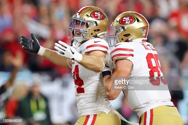 Kyle Juszczyk of the San Francisco 49ers celebrates with George Kittle after scoring a 15 yard touchdown in the second quarter against the Kansas...