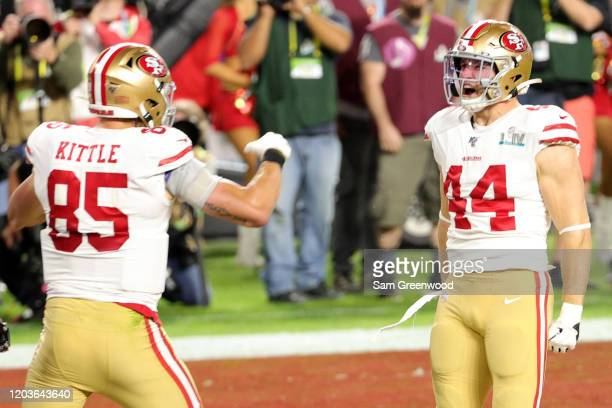 Kyle Juszczyk of the San Francisco 49ers celebrates with George Kittle of the San Francisco 49ers after a 15yard touchdown in the second quarter of...