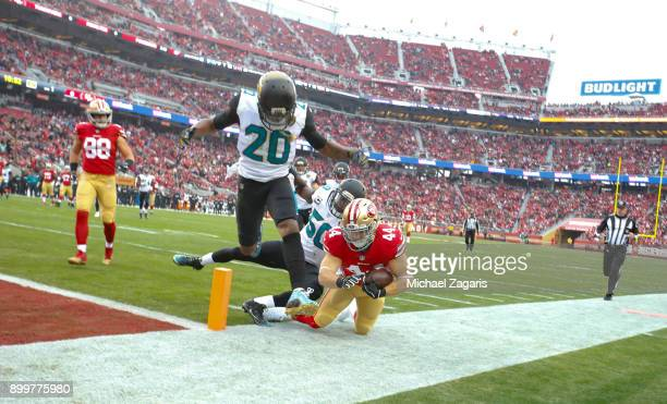 Kyle Juszczyk of the San Francisco 49ers gets knocked out of bounds at the 1yard line during the game against the Jacksonville Jaguars at Levi's...