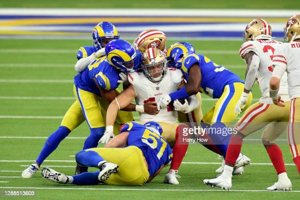 Kyle Juszczyk of the San Francisco 49ers is tackled by the Los Angeles Rams during the fourth quarter at SoFi Stadium on November 29, 2020 in...