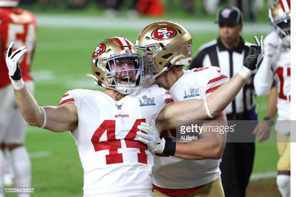Kyle Juszczyk of the San Francisco 49ers reacts after a 15yard touchdown reception against the Kansas City Chiefs during the second quarter in Super...