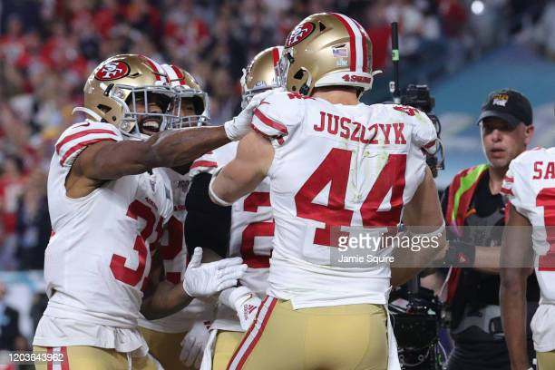 Kyle Juszczyk of the San Francisco 49ers reacts after a 15-yard touchdown reception against the Kansas City Chiefs during the second quarter in Super...