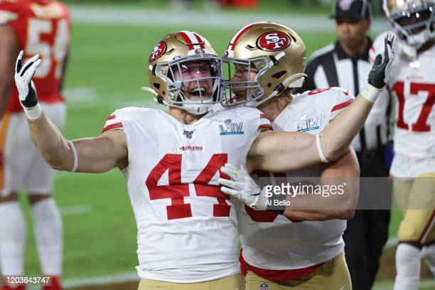 Kyle Juszczyk of the San Francisco 49ers reacts after scoring a touchdown on a 15yard reception against the Kansas City Chiefs during the second...