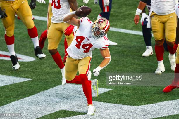 Kyle Juszczyk of the San Francisco 49ers reacts after scoring a touchdown during the first half of a game against the New England Patriots on October...