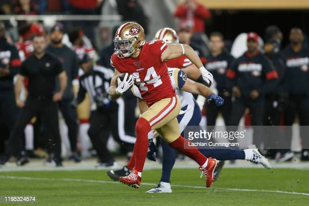 Kyle Juszczyk of the San Francisco 49ers runs the ball in the second quarter against the Los Angeles Rams at Levi's Stadium on December 21 2019 in...